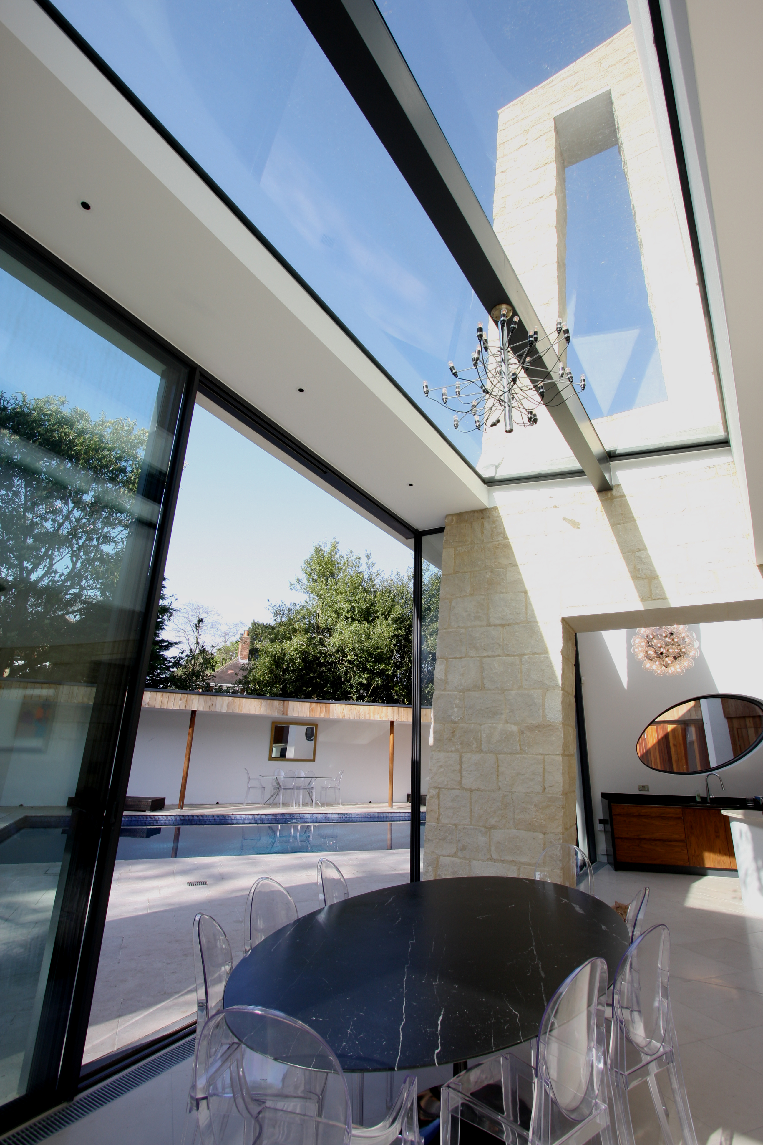 A glass roof to a contemporary home in Richmond using steel supports