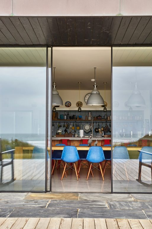 sliding doors with slim frames by sea