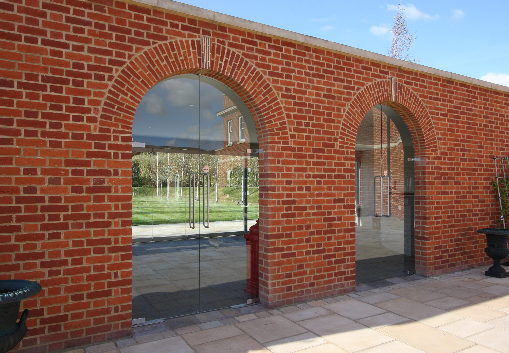 frameless glass doors with arched head