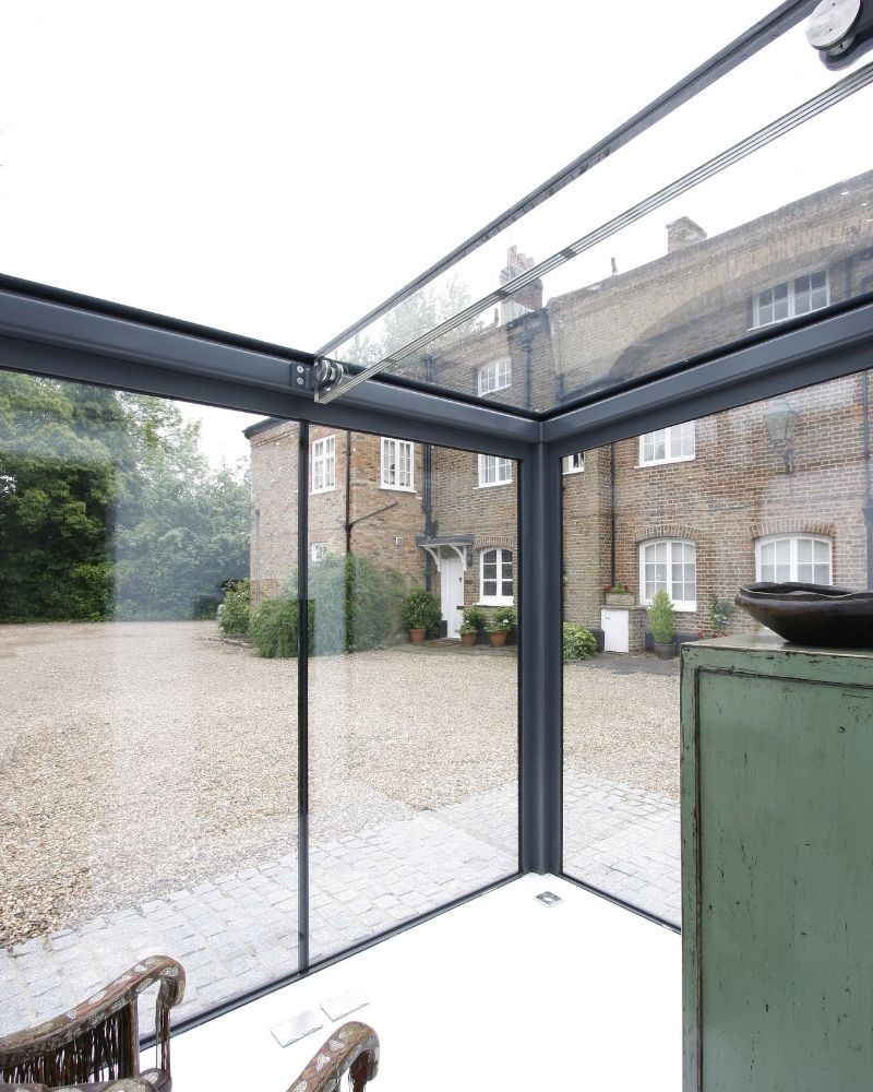 glass extension to traditional cottage house