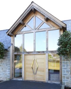 Structural glass gable end windows with timber frames
