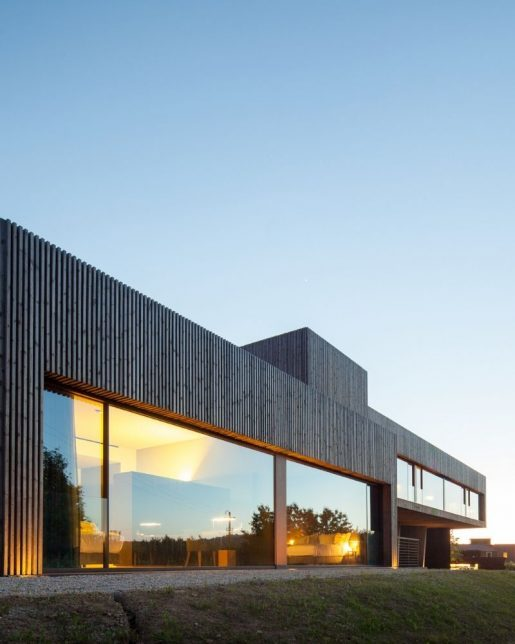 large glass facade on coastal house