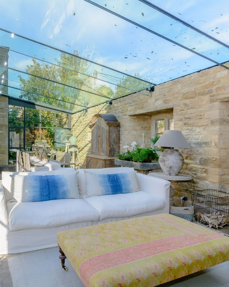 glass roof with cotswold stone wall