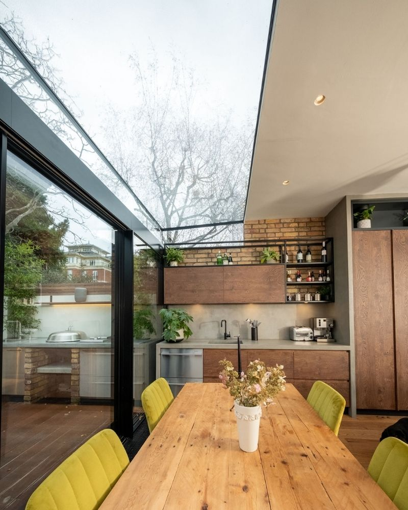 a frameless glass roof over kitchen extension