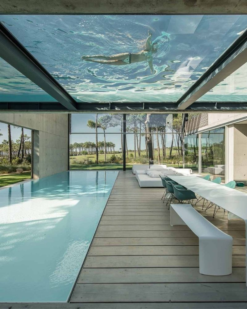 a glass bottom swimming pool