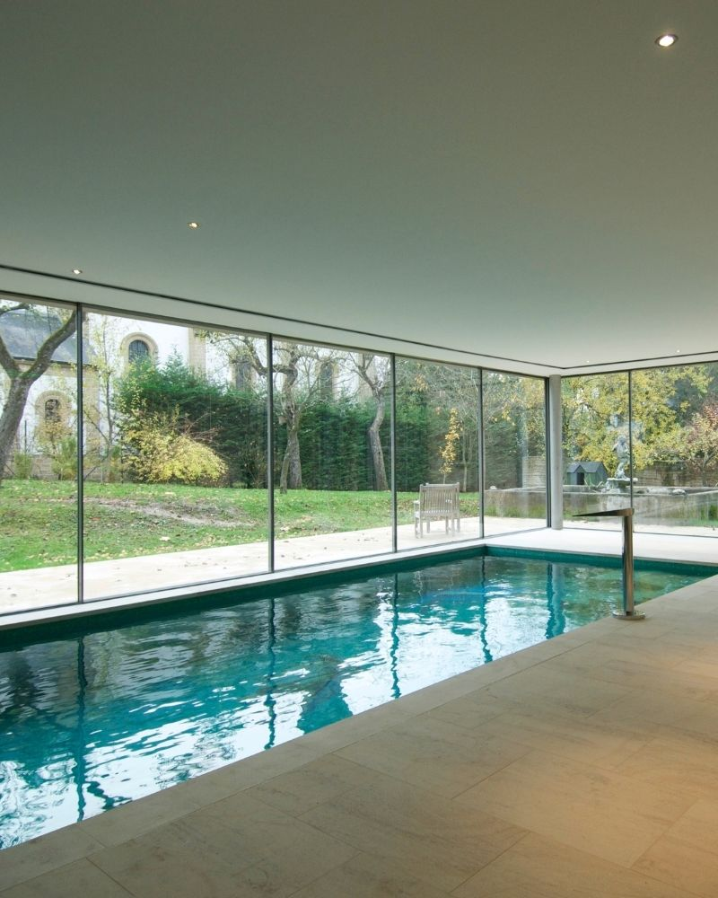 indoor swimming pool with minimal glass walls