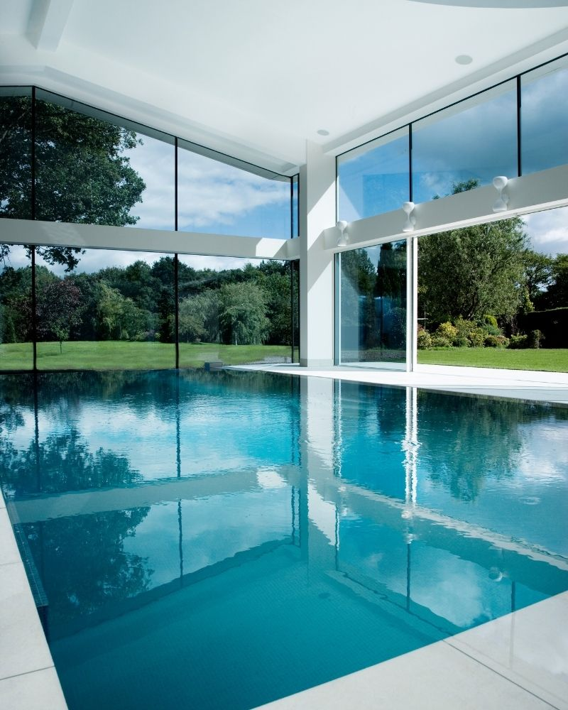 a luxury glass walled swimming pool