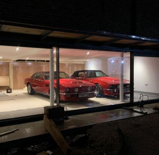 luxury residential car garage with Aston Martin vantage v8 which was 'Britain's first super car'