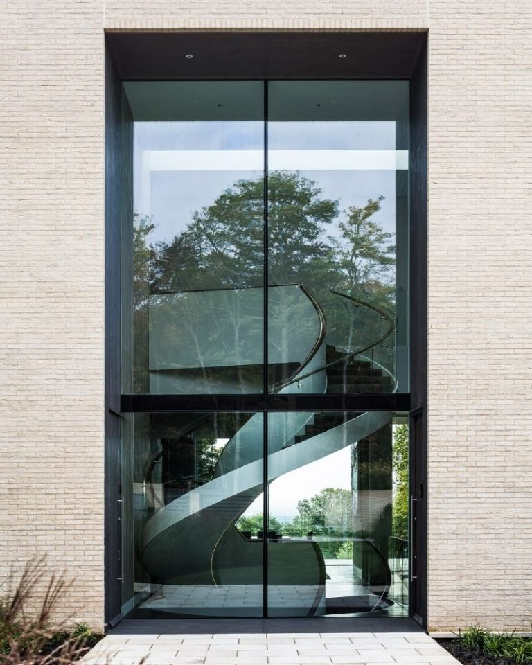 high acres barnet - double height glass elevation by the stairwell of a modern villa