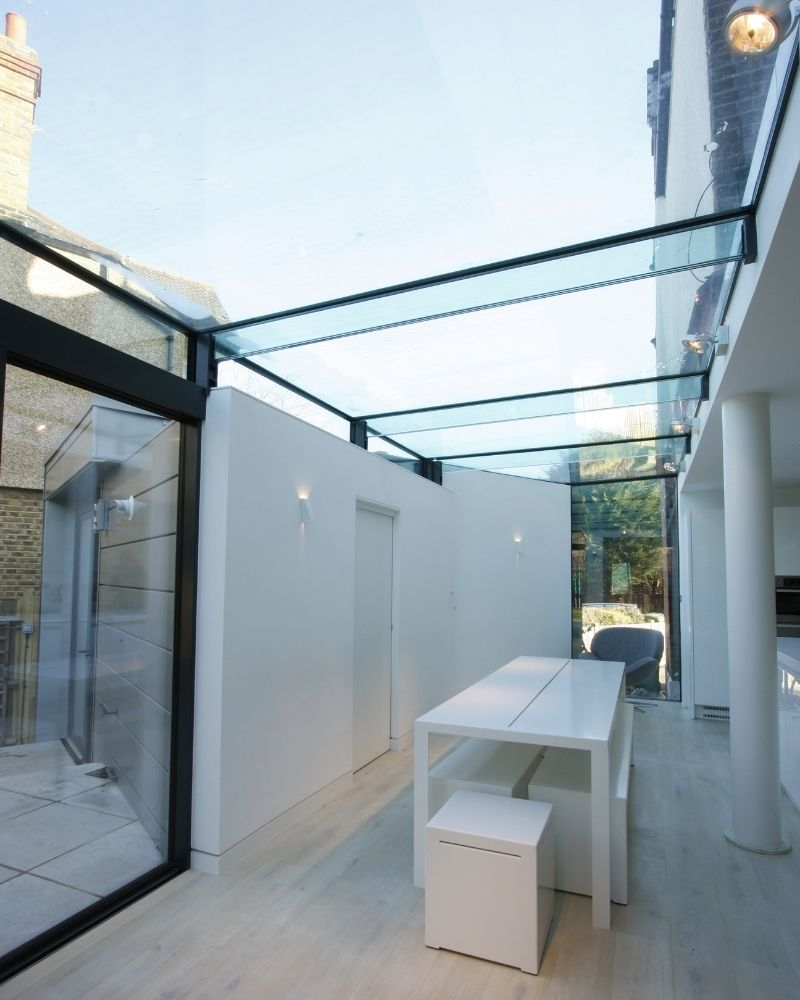 a large glass roof to a side extension in london