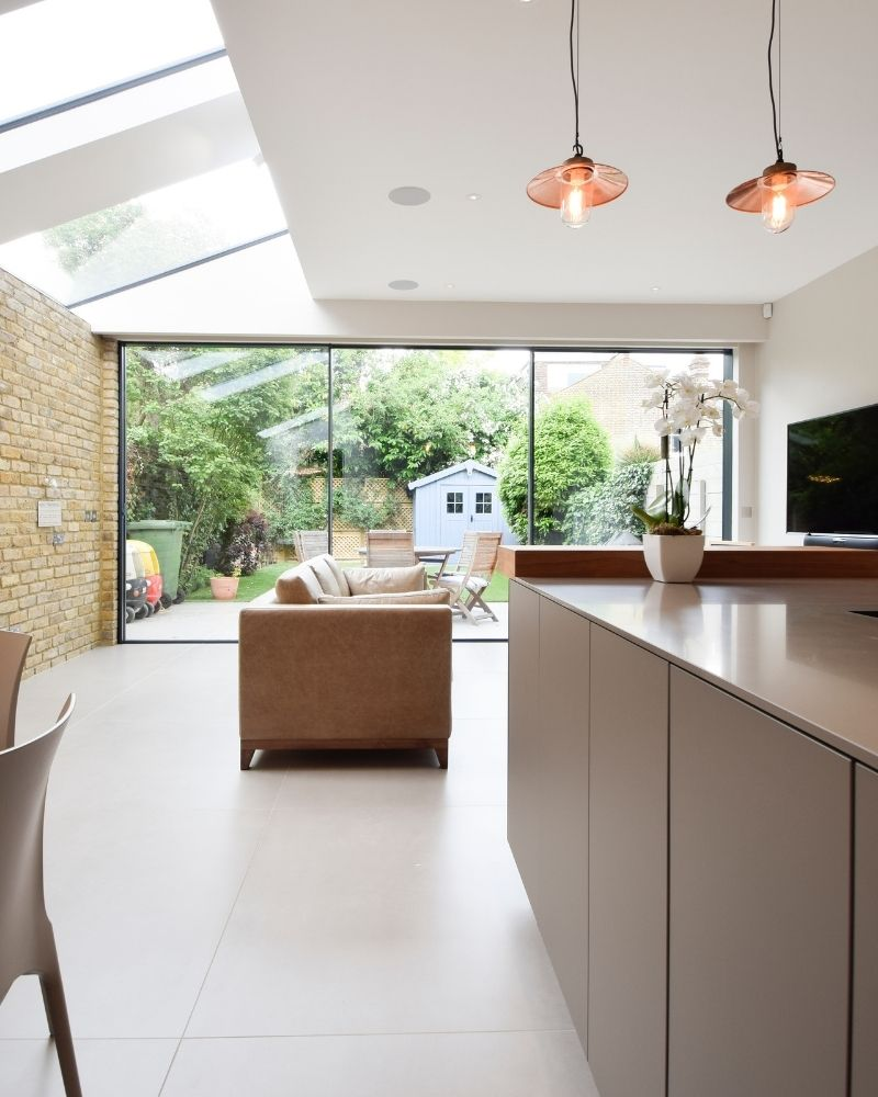 a modern side return extension with large glass doors to the rear
